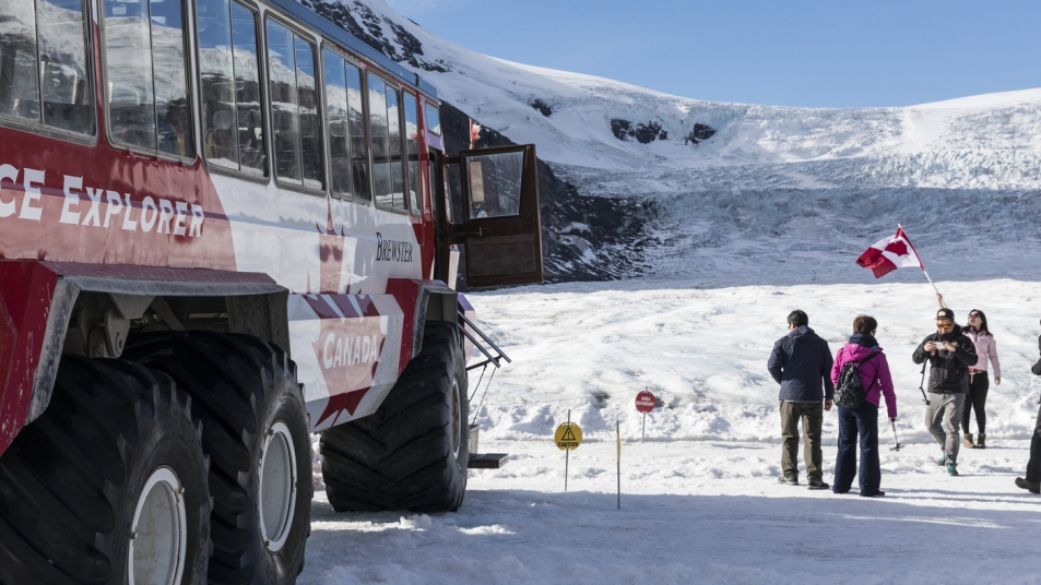 A Giant Ice Explorer transports visitors to the Athabasca Glacier.