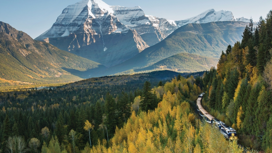 Rocky Mountaineer with Mount Robson, the tallest peak in the Canadian Rockies, in the background.