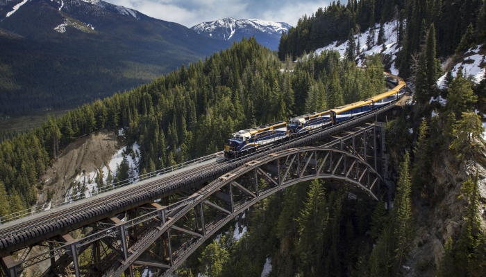 rocky mountaineer train crosses stoney creek bridge