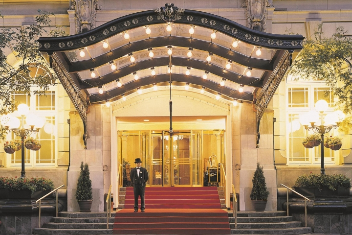 fairmont palliser in calgary entrance lit up at night