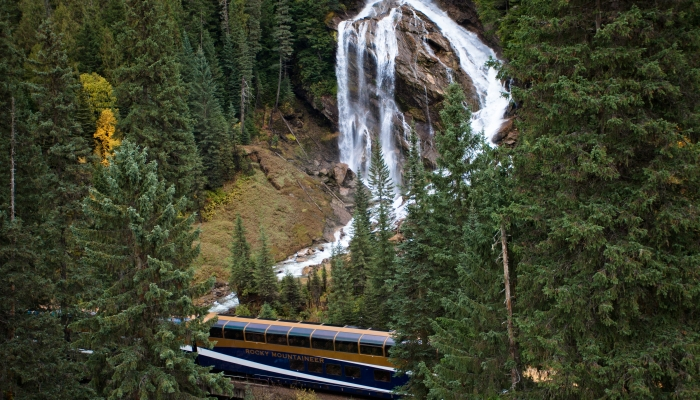 rocky mountaineer train passes by pyramid falls on the journey through the clouds route on the way to jasper