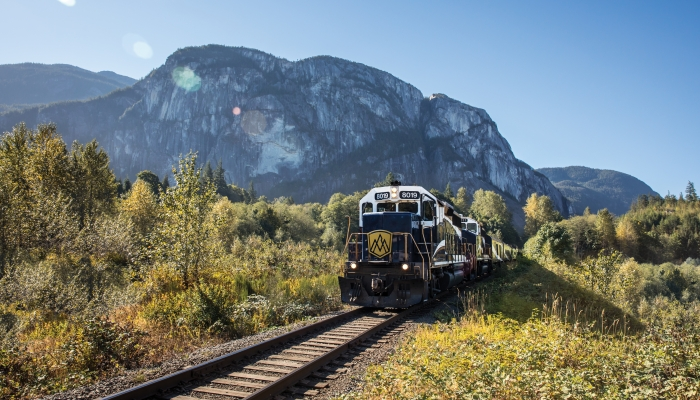 rocky mountaineer train passes by The Chief Mountain in Squamish