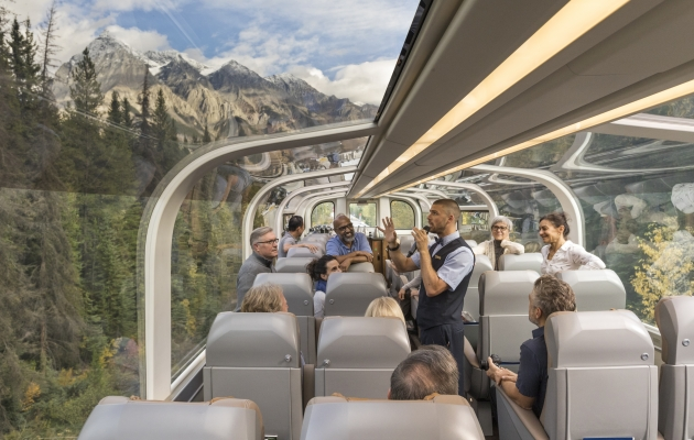 Rocky Mountaineer host tells story to guests